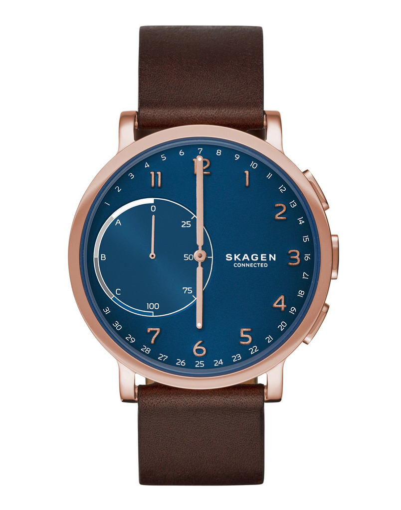 If you are more conservative with your styling choices, The Hagen Connected hybrid smartwatch combines innovative technology with classic design. Features include automatic time and date adjustment, activity and goal tracking, sleep tracking, filtered smartphone notifications, dual-time function, alarm, and SKAGEN LINK technology, which allows the wearer to snap a photo, control their music and more—all with the push of a button. Hagen Connected is compatible with Android™ phones and iPhone® and syncs wirelessly with the SKAGEN app, where you can view your data and manage settings. The watch runs on a standard coin-cell battery with a four- to six-month battery life, so it never needs to be recharged. And the quick-release-pin construction makes it easy to interchange the ion-plated steel-mesh band with other 20mm leather, steel-mesh, nylon or silicone straps.  Skagen Connected -$195