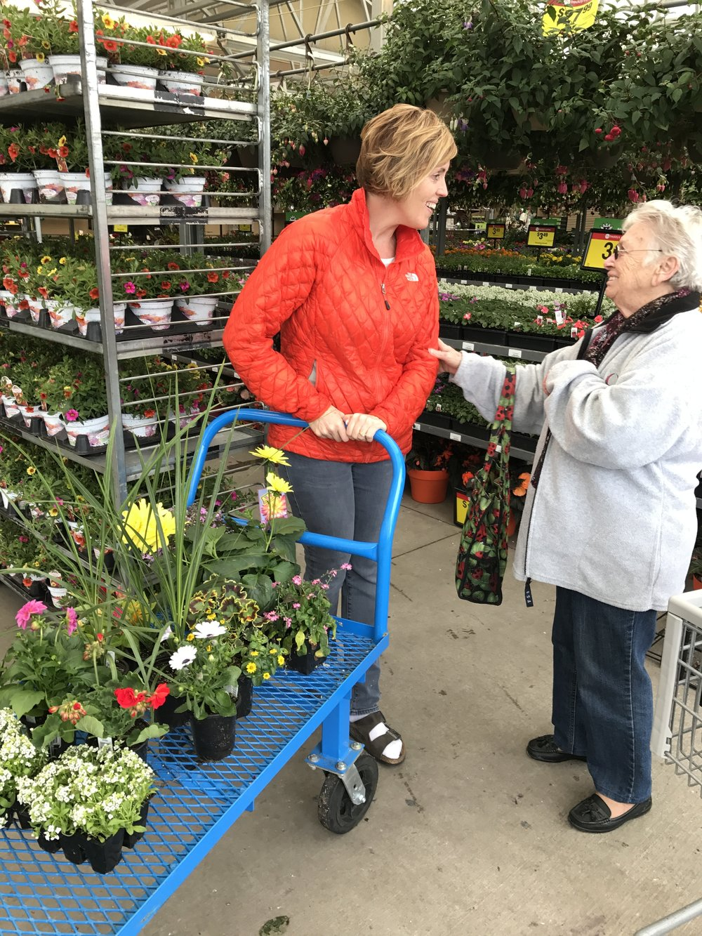 Buy birthday flowers and meeting this really sweet lady from Germany. I was so tickled that my hubby took a picture!