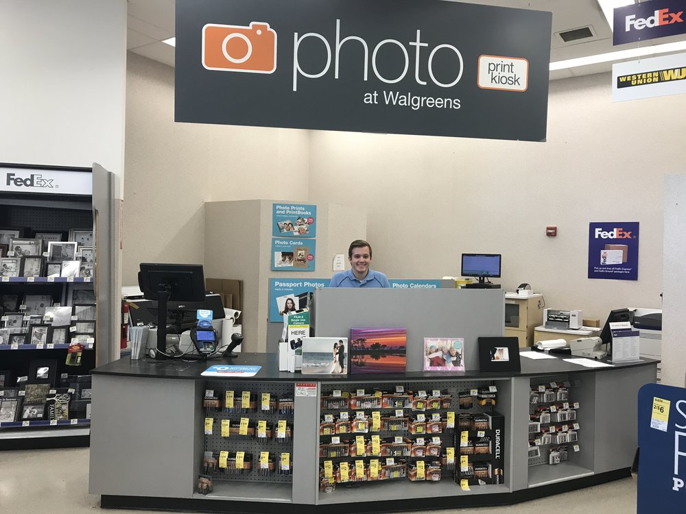 Chase works at Walgreens, where he often mans the Photo Center. Just look at that smile!