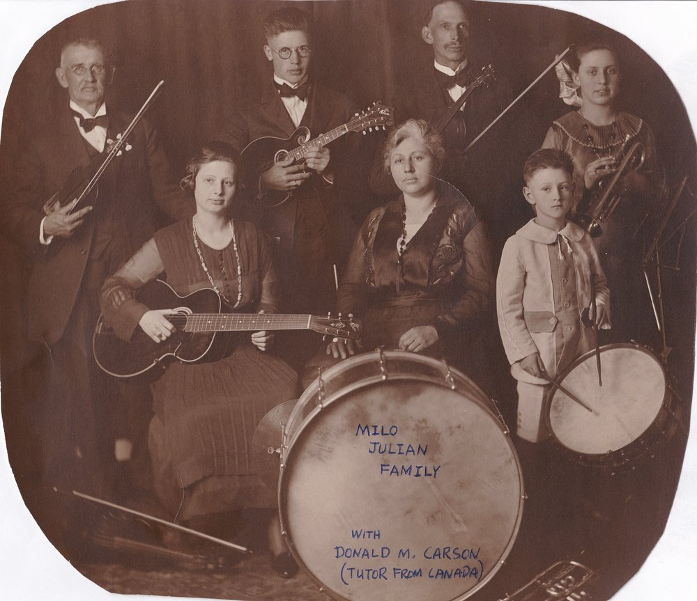 The Milo Julian Family Orchestra. circa 1920 Please note that I am very grateful to have this photo, but also sad that my father in law trimmed the corners and wrote on it with a ball point pen. Please do not do anything to an original photo that cannot be undone.