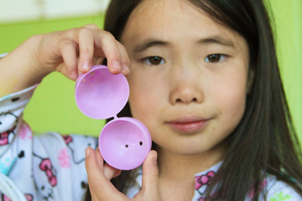"""I put an empty egg in each child's Easter basket. The symbolism is an opportunity to remember the Savior's resurrection while enjoying and honoring a secular tradition. This is Addie with her """"empty egg"""" 2014."""