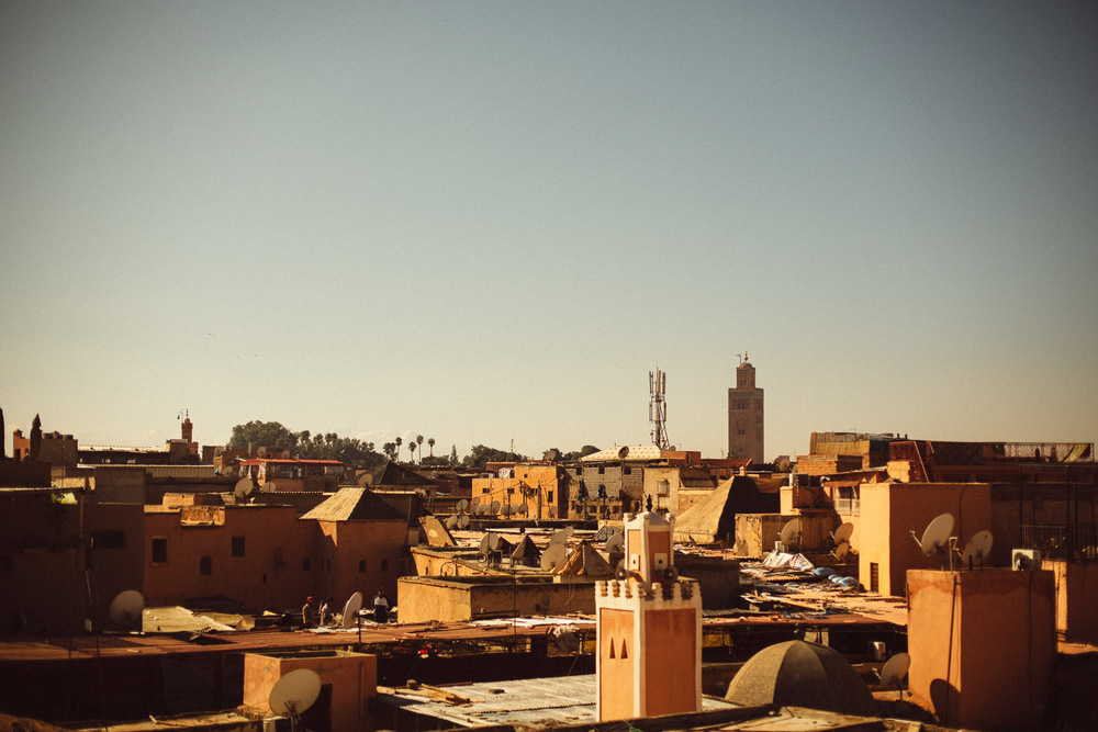 City of Marrakech, Morocco. Taken from a rooftop near the Spice Market, looking towards the Koutoubia Mosque and the Jamaa el Fna night-market.