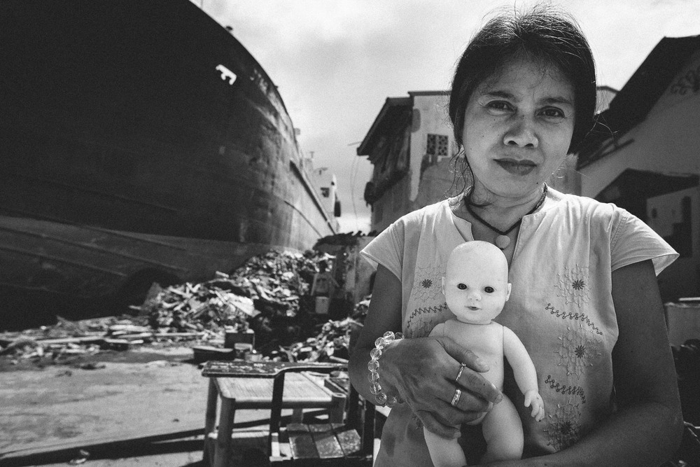 Tacloban City. A grieving woman grasping the doll she believes to be her child. The storm surge ripped her real child from her arms as she tried to protect her.