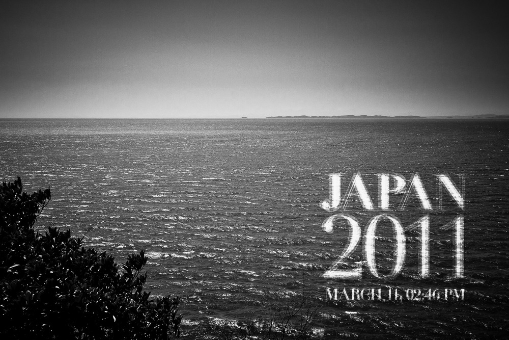Ishinomaki Bay, looking south over the sea. The face of the ocean is calm, as if today was no different than yesterday. Behind, the city of Ishinomaki is recovering from the impact with the tsunami waves that rushed passed here, directly towards the city center.