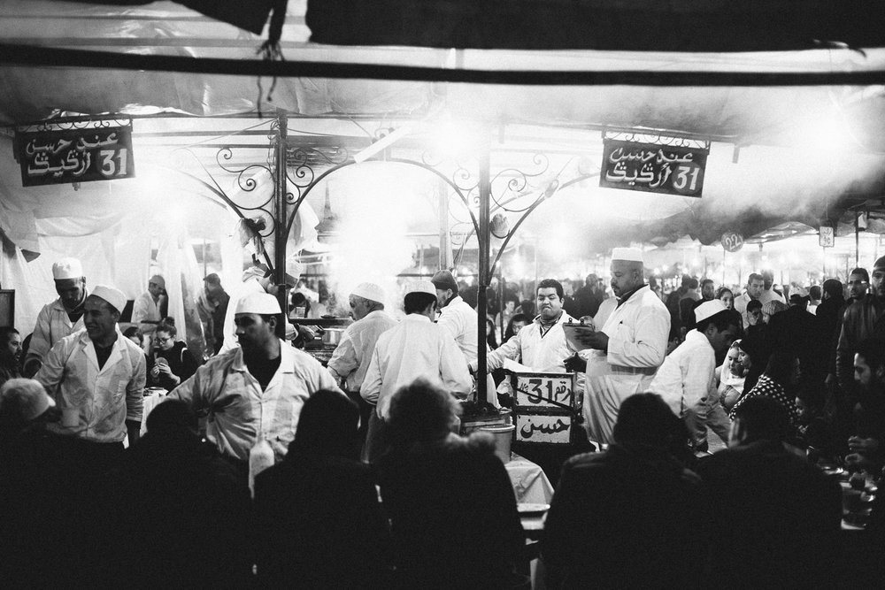 Marrakech, Morocco.  Dating back to the 12th century, the night-market of Jamaa el Fna is a perfect chaos of food stalls and people.