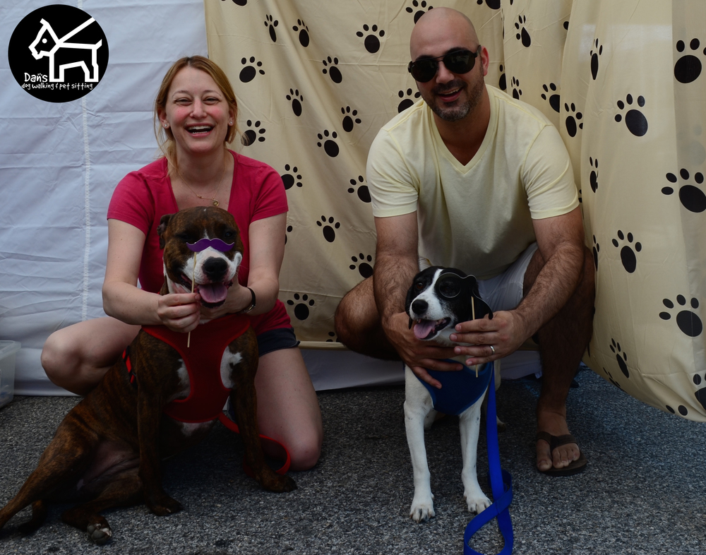 Beth and Dean are all smiles at Dan's Dog Walking and Pet Sitting Doggie Photo Booth at Harbor Fest 2015.jpg