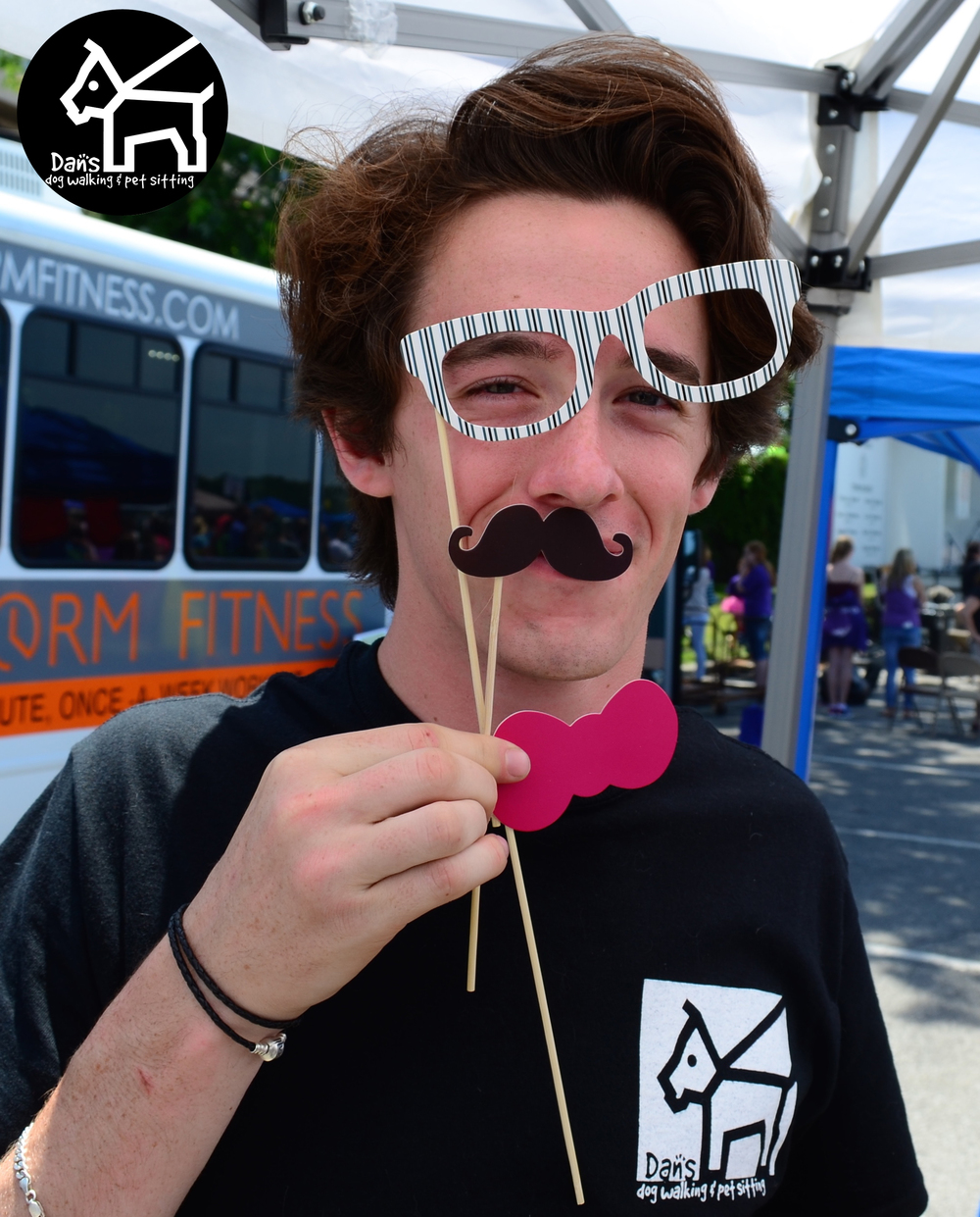 Dan Enjoying the Props at Dan's Dog Walking and Pet Sitting Doggie Photo Booth at Harbor Fest 2015.jpg