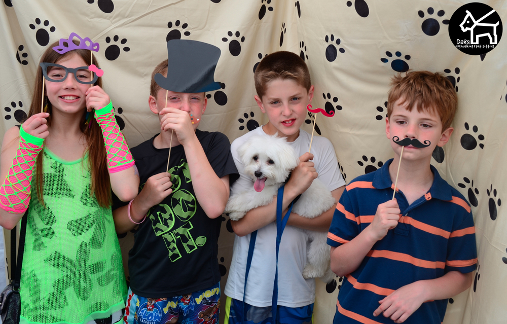 Kids Enjoying the Dan's Dog Walking and Pet Sitting Photobooth.jpg