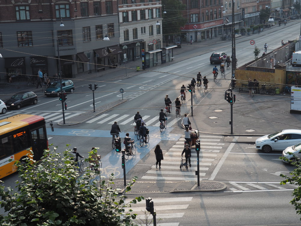 Norrebrogade, Copenhagen - a separated bike lane and associated street innovations such as a 'floating' bus stop, cycle lane marking through the intersection rather than along the street, traffic lights for cycles, and street lighting hung from wires.