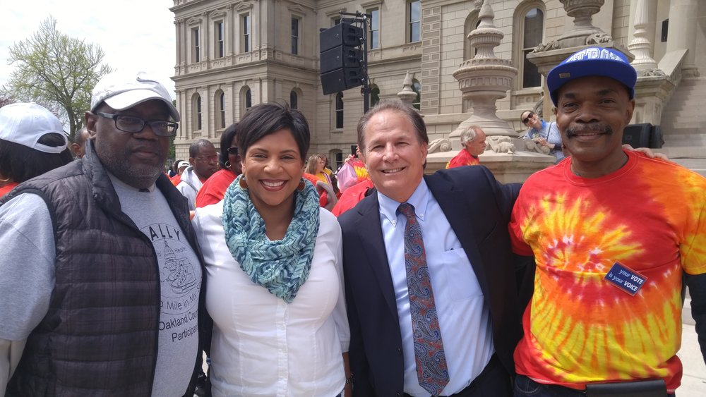 Willie Brooks, Executive Director & CEO of Oakland Community Health Network; State Representative Sylvia Santana; DWMHA CEO Tom Watkins and Loren Glover of The Arc Detroit.   The arc detroit participated in Walk a Mile in my Shoes may 10,2017 In Lansing Michigan