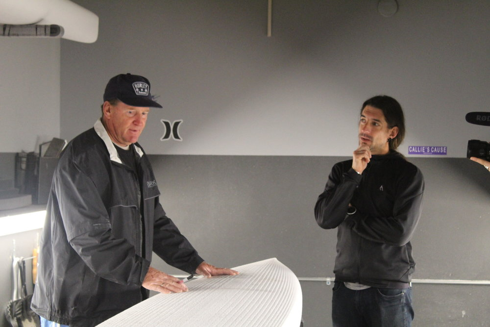 Karl visiting Joe's shaping room to design his new board.