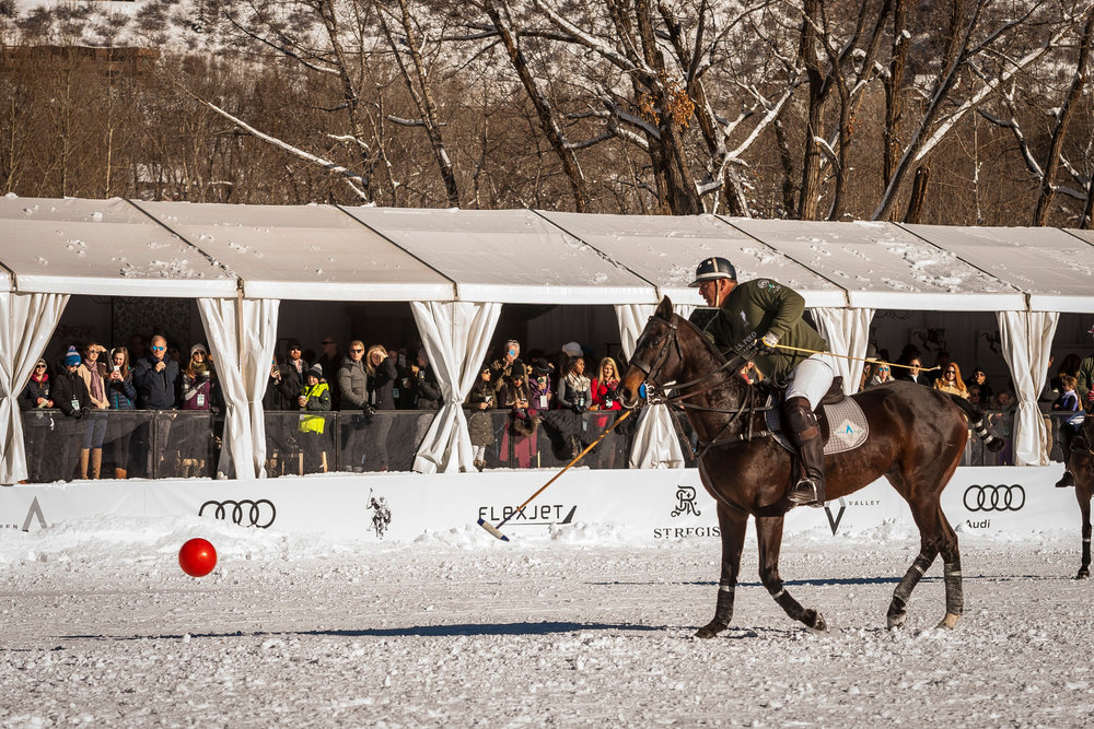 A soldout VIP tent at Rio Grande Park watches snow polo action.