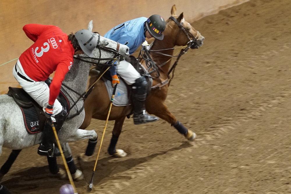 Carlitos Gracida of Aspen Valley Polo Club and Luis Escobar of Audi battle for the ball.
