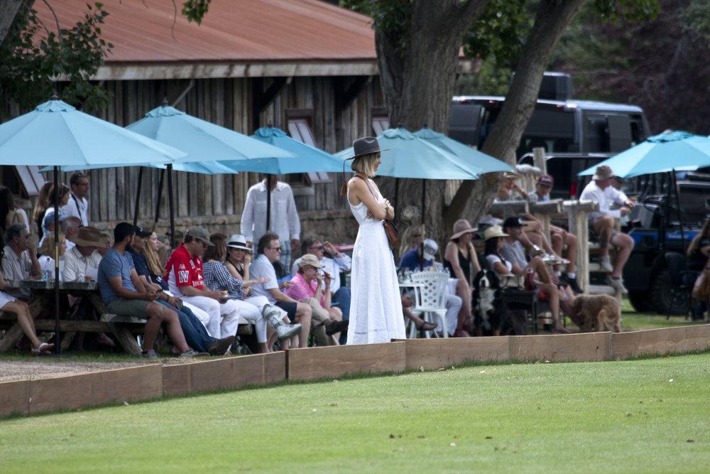 Delfina Blaquier watches her husband Nacho Fig.JPG