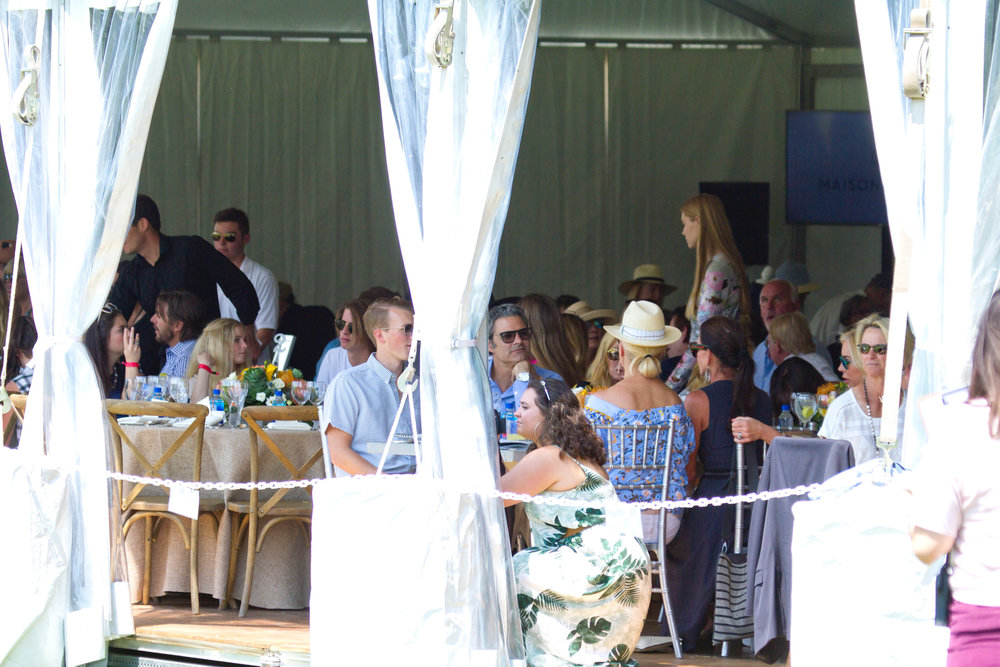 Guests socialize and enjoy good polo, good food an.JPG