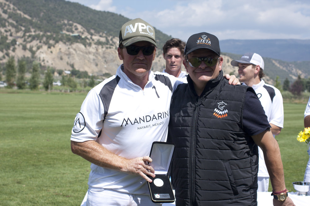 Marc Ganzi of Mandarina White receives his.JPG