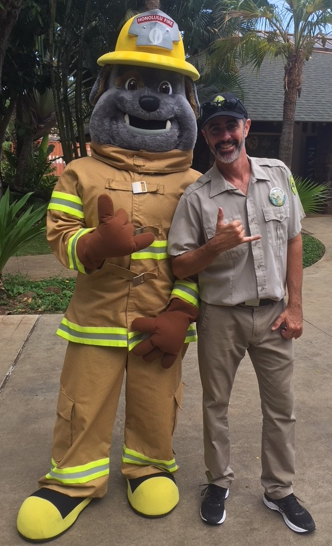 Mike shakas with Poki, Honolulu Fire Department's mascot at the Honolulu Zoo during Fire Prevention Week. Photo: Mike Walker