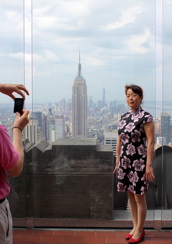 I love this picture. The dainty position of the picture-taker's hand, the formal dress and pose of the model, the Empire State Building in the center... it kind of embodies everything I love about Japanese tourists.