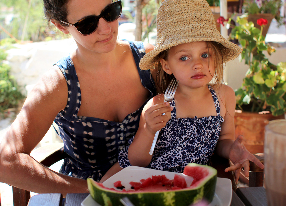 This is the look on a mommy's face when her little girl will eat only watermelon and drink only watermelon juice. This is probably the sixth meal in a row on her all-watermelon-mono-diet. She knows it irritates us and she responds by humming sweetly, batting her eyes, and wiggling her little fingers with happiness.