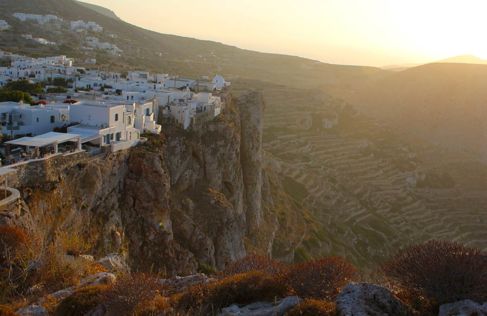 "We just happened to pick the perfect time to hike up to the very top of the island, up the steps of ""the zig zag church,"" right as the sky was turning rose gold. Seeing the main village, the Chora, perched on the edge of that cliff, teetering above the terraced rocks below, drenched in liquid sunshine and golden light – it was quite a magnificent site."
