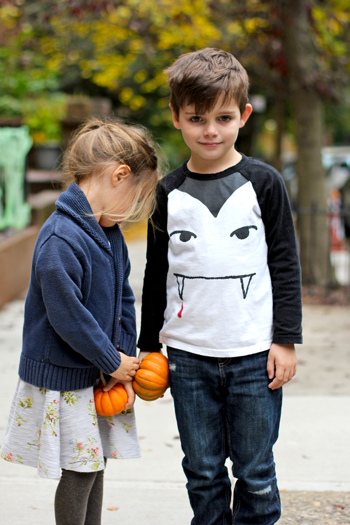 """On our way to see Beauty and the Beast at the puppet show. (Alice keeps saying  """"Sleeping Beauty and the Beast."""" )Since it's only a block away, we can leave our coats and bring pumpkins."""