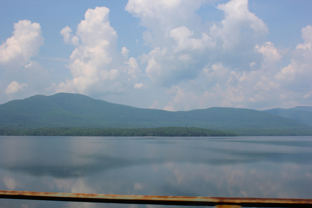 Every time I take pictures out the window of a moving car I shake my head at myself, knowing they'll just be blurry messes. So I was floored to see that these actually looked lovely! Driving to an excursion took us around the Ashokan Resevoir, still and clear, and dotted with the reflection of white marshmallow clouds.