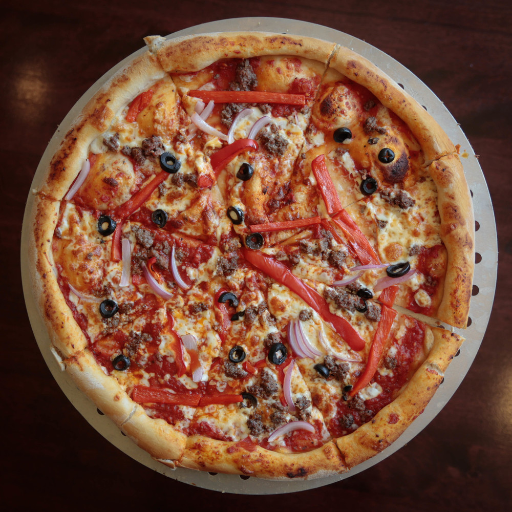 House-made pizza with onions, peppers and black olives at the Golden Pony in Harrisonburg, VA.
