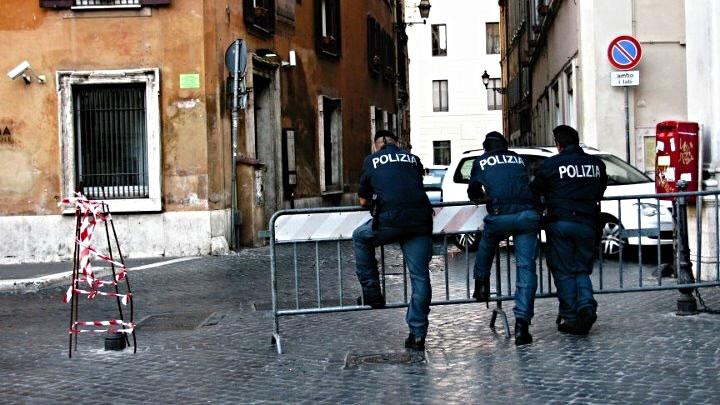 2011: Policemen take a break from patrolling in Rome, Italy.