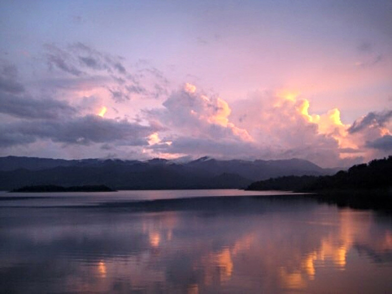 2008: A reflective sunset behind voluminous clouds in Arenal, Costa Rica.