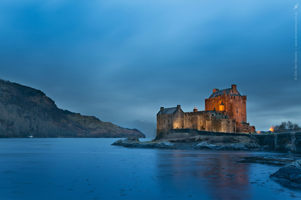 Night Descends | Scotland, United Kingdom February 2014 Dusk looms over the enigmatic visionof Eilean Donan Castle, on the upper western coast of Scotland. Purchase printshere