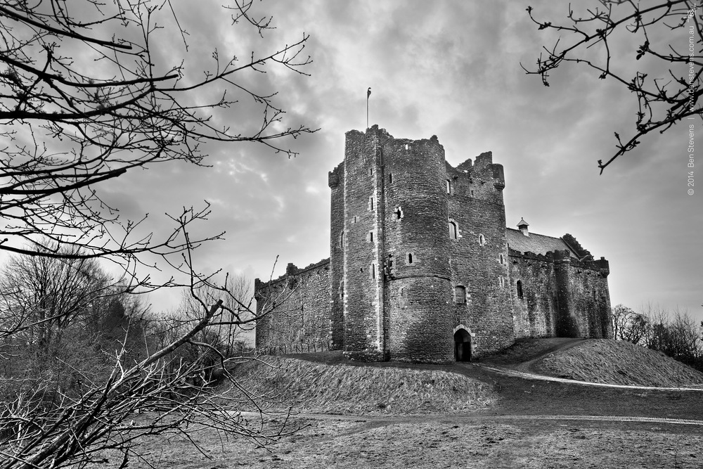 Run Away! |Scotland, United Kingdom February 2014 The eerie shape of Doune Castle on a gloomy, overcast day.TheCastle is famous for being the set of many films and TV shows, the most well known being Monty Python's 'The Holy Grail'. Purchase printshere