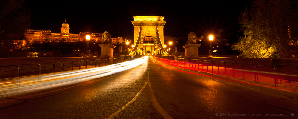 Coming and Going |Budapest, Hungary April2014 Chain Bridge, Budapest's famous landmark, carries an unending stream of cars, even late at night. The Nazis destroyed this bridge in WWII, but it was later rebuiltas an exact replica of the original. Purchase printshere