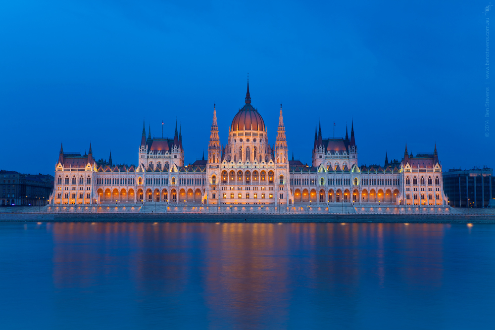 1896 |Budapest, Hungary March 2014 Parliament House wasbuilt in the lead up to the 1896 olympics held in Hungary andlights up spectacularly along the banks of the Danubeat dusk. Purchase printshere