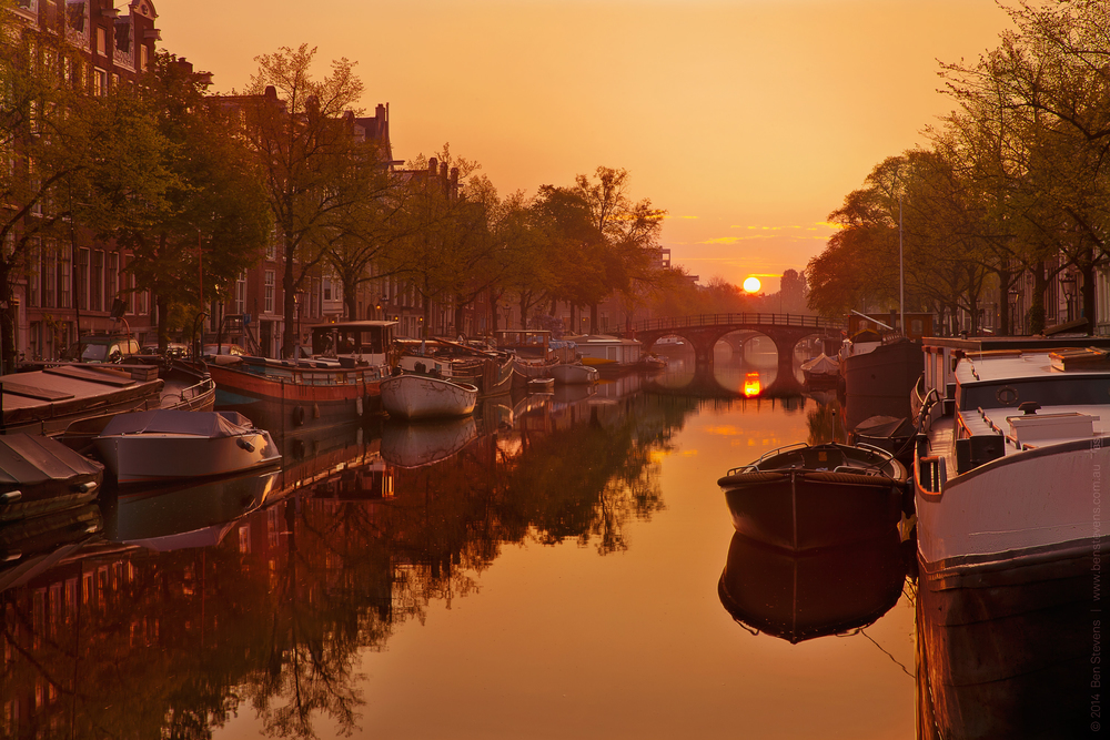 Quiet Canal 2|Amsterdam, Netherlands April 2014 The sun rises over one of the many canals in Amsterdam in the early hours, as the city quietly wakes up. Purchase printshere