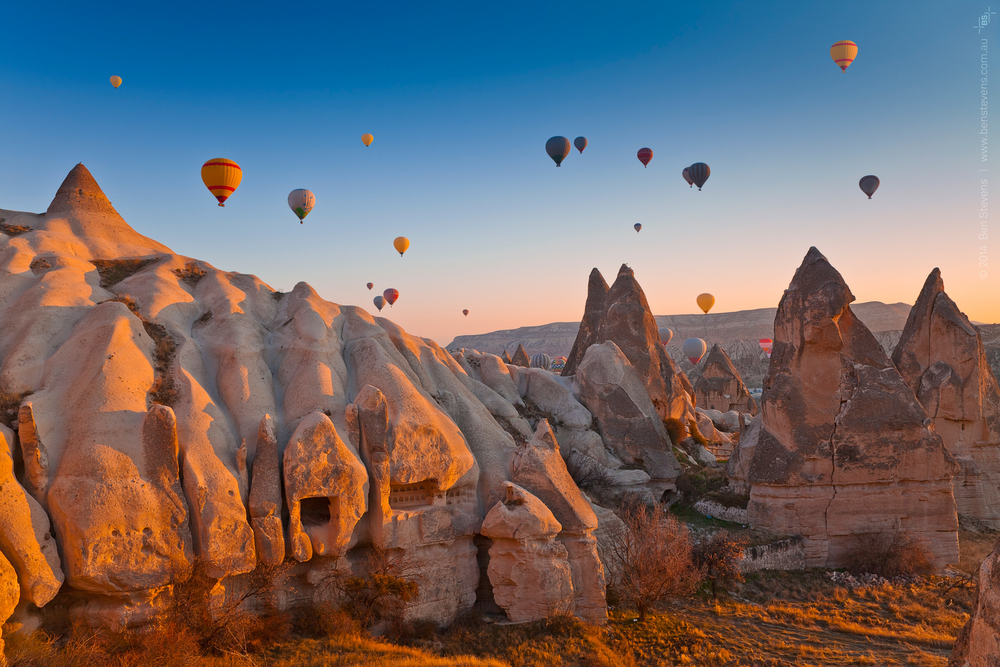 AncientsRising |Cappadocia, Turkey March 2014 Favourable conditions before dawnallow the famous hot air balloons of Cappadocia to rise above the strange landscape of Cappadocia, Turkey. Purchase printshere