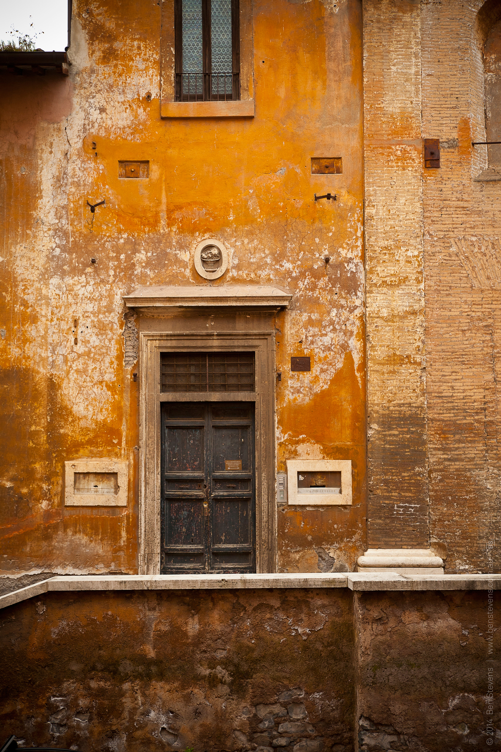 Roman Apartment |Rome, Italy March 2014 One of the many ancient doorways in Rome that conceal theirmore modern interiors. Purchase printshere