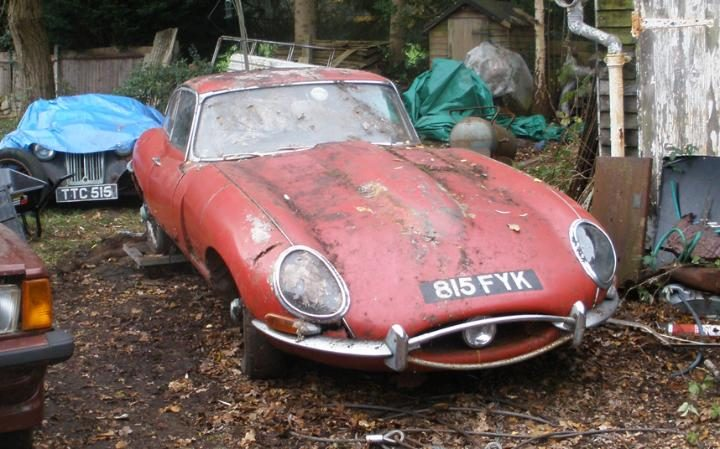 "Paul Hudson , Deputy Editor, Telegraph Cars 9 March 2016 • 9:36am A 1963 Series 1 E-type has sold for £57,900 at auction, despite requiring a full restoration  A Jaguar E-type found under a hedge in the village of Bisley in Surrey sold at auction yesterday evening for £57,900 including commission. Although it was sold without a reserve price, the spiralling values of E-types meant that this 1963 example with only 44,870 miles on the clock was highly sought-after - despite requiring extensive restoration. It still has the last tax disc on its screen, which expired in November 1969. The early Series 1, 3.8-litre car  is finished in Carmen Red with a tan interior. It is one of 1,799 right-hand-drive, fixed-head coupes built. With an inline six-cylinder engine developing 265bhp, the car was capable of a top speed of 150mph and 0-60mph in less than 7 seconds The car's first owner in May 1963 was Ivor Arbiter, who designed the early Beatles logo with the dropped capital T to emphasis the ""beat"" part of the band's name. In November 1965 the car passed to SB Cain of Greenford, who sold it to garage owner Howard H Measham, who used it for a short period. In December 1967 the car moved to its last owner, Frank Riches, who raced it between 1967 and 1969. James Good, a valuer at auctioneer Coys, which is sold the car, said: ""This wonderful Series 1 E-type is in original condition, with matching numbers and has never been restored. It is ideal for restoration and is extremely rare. It has a great history, including racing, which collectors love."" The car was sold with its original brown log book, V5 and V5C, its last MoT certificate from November 1968, the sales invoice to Frank Riches for £855 along with a Jaguar heritage certificate confirming all the important details. It also has its original service handbook and manual, a spare parts catalogue and the original jack. It was sold at the Coys Spring Classics auction at the Royal Horticultural Society hall in Westminster."
