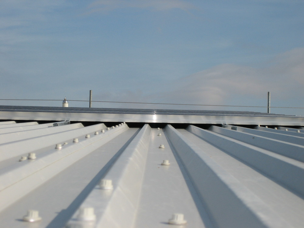 PV frame and modules mounted flush to composite roof.JPG