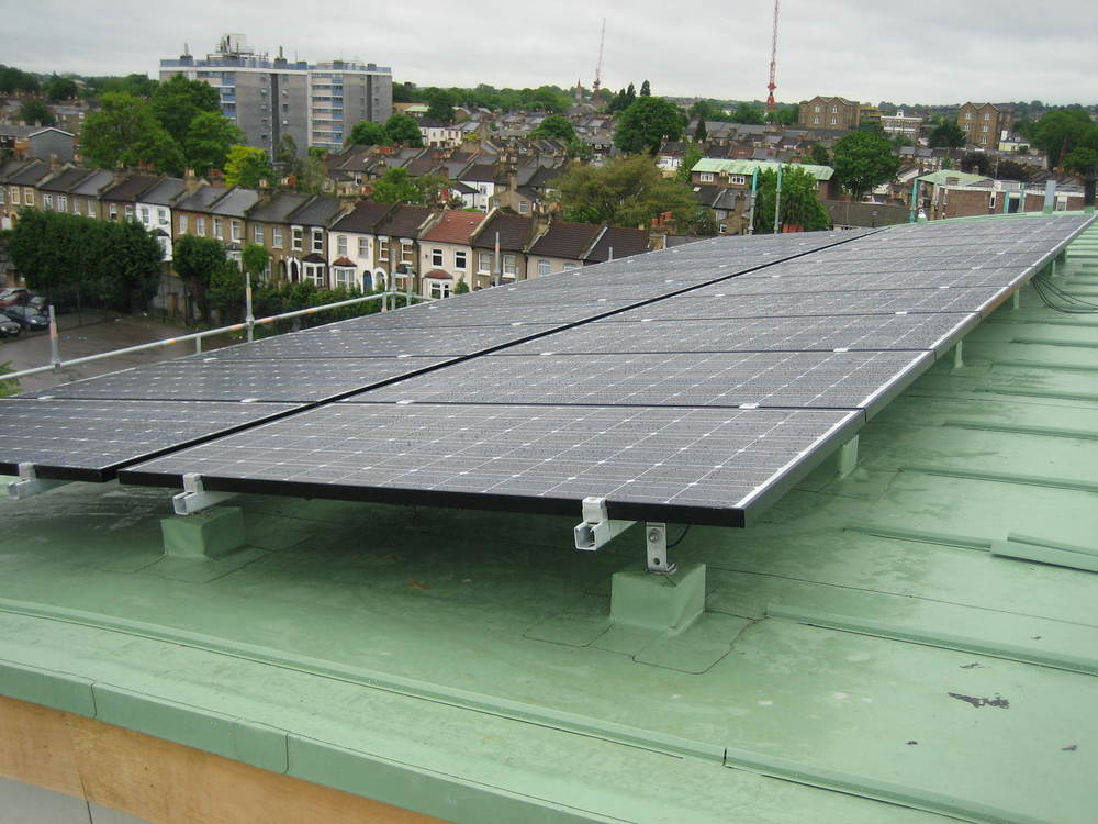 PV frame mounted system on singleply membrane roof, Sanyo Modules - Peckham.JPG