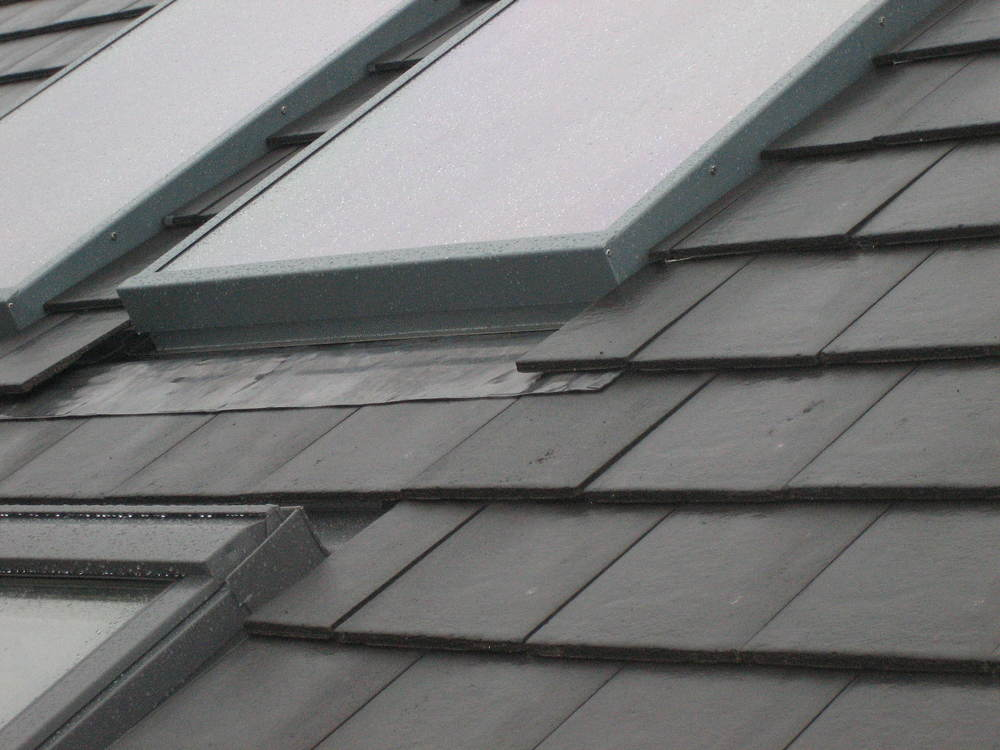 Solar air collectors integrated into a concrete tile roof.JPG