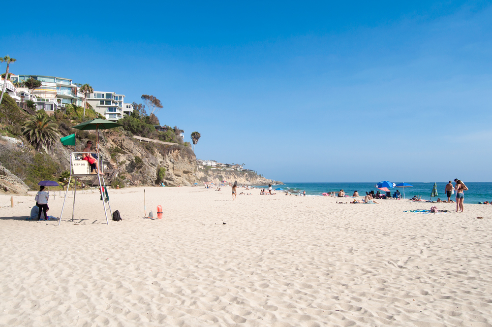 After passing some bathrooms and showers at the bottom of the stairs, you hit the beach. Once on the sand, I have no doubt you'll agree this is one of the most beautiful bluff covered sand beaches in all of Orange County.