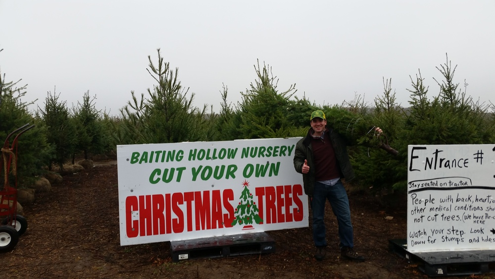 A satisfied customer and his tree.