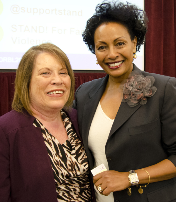 STAND! CEO Gloria Sandoval and domestic violence survivor Menbere Aklilu.
