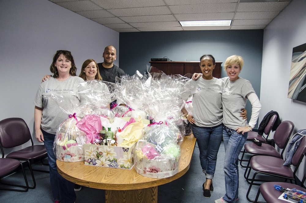 Final gift baskets with awesome volunteers from LM.jpg