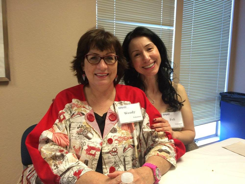 Wendy, left, and fellow STAND! volunteer, Feli, right, at our Volunteer Appreciation Dinner.