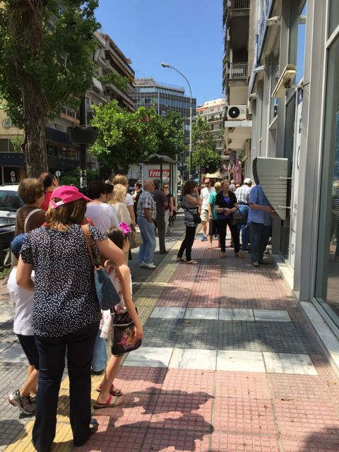 People lined up all over Athens to withdraw funds from their bank accounts during the EU Greek crisis. I snapped this photo on July 1, the day I left Greece.