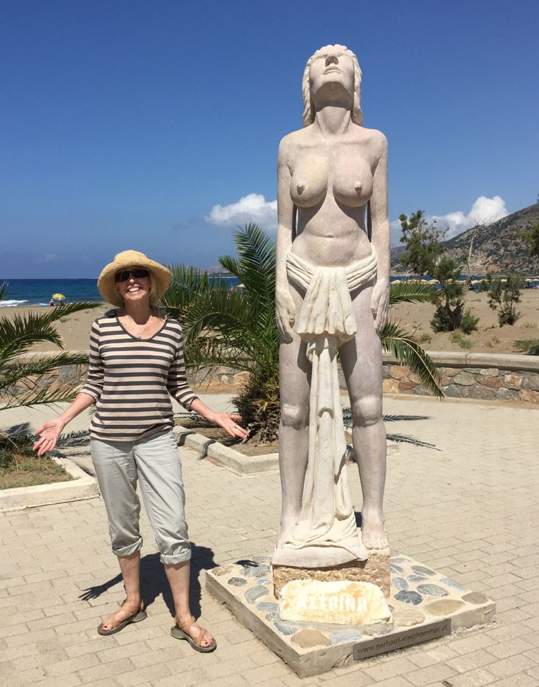 This is me next to a statue of a Greek sunbathing goddess at Paleochora