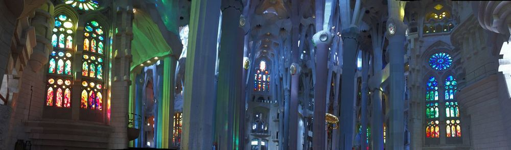 In this panoramic shot inside Gaudi's Sagrada Familia in Barcelona you can see the riot of color as the sun streams in from stained glass windows.
