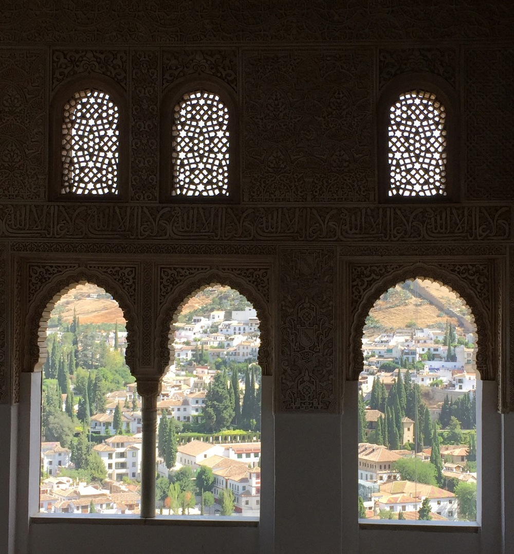 Inside the Alhambra palace looking out at the Albaicin in Granada.
