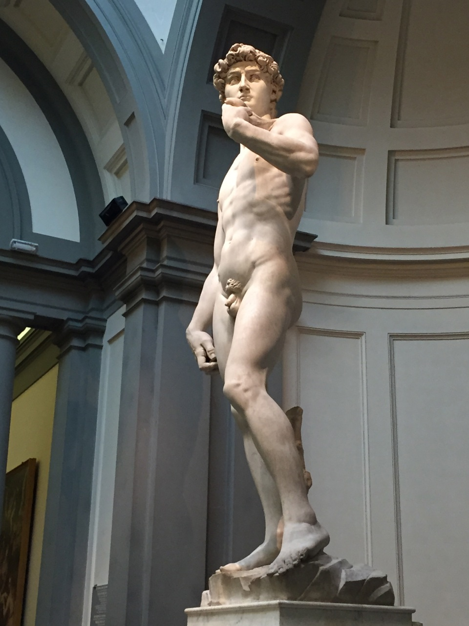 Michelangelo's statue of David in Florence, with the Biblical David preparing to slay Goliath with a slingshot.